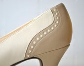 Ivory cream and tan vintage spectator pumps