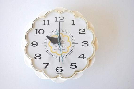 Vintage wall clock, white with scalloped edges and aqua blue second hand