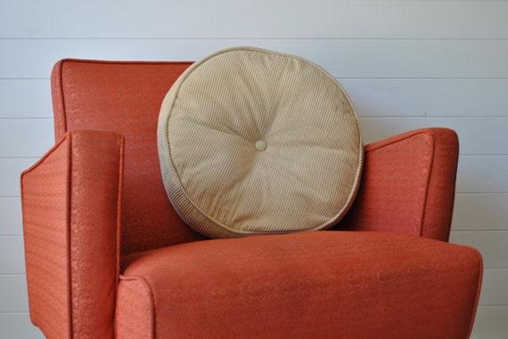 Round  tan corduroy pillow