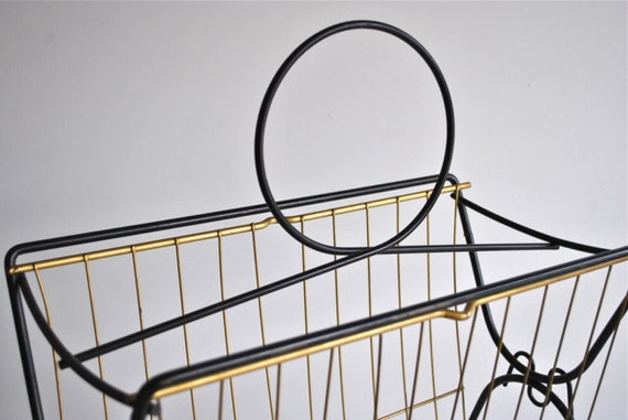 Mid century magazine rack black and gold brass atomic