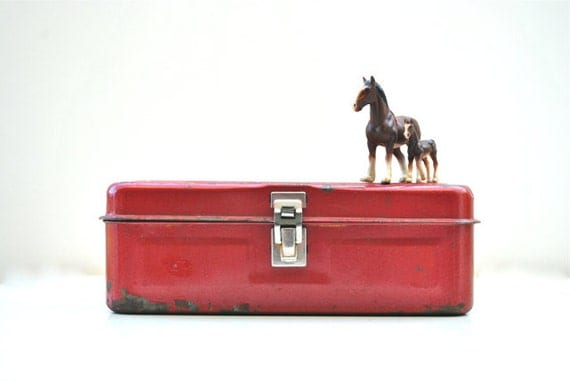 Rusty red little toolbox
