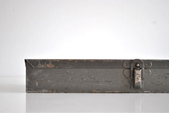 Gray Industrial Metal Box filled with Doctor's supplies