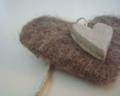 Needle felted heart with ceramic heart