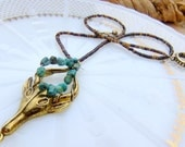 Brass Maenad Mask Charm and Heshi Shell Necklace with Halo of Genuine Turquoise Nuggets