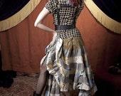 long ruffle skirt, size medium, of cotton plaid homespun, paisley, and lighthouse printed fabric