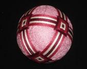 Temari Ball Ornament Bands of Burgundy and Raspberry on Pink