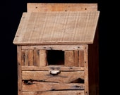 Hand crafted bird house made from antique wooden boxes.
