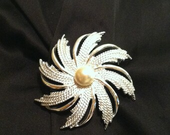 Silver tone brooch by Sarah Coventry