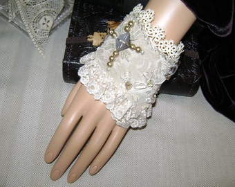 Art to wear, one of a kind hand beaded fabric cuff