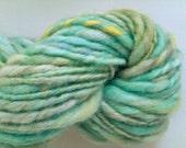 Aqua, lime and lemon chunky spun. Hand spun, hand painted art yarn. Pure Australian 21 micron merino wool.