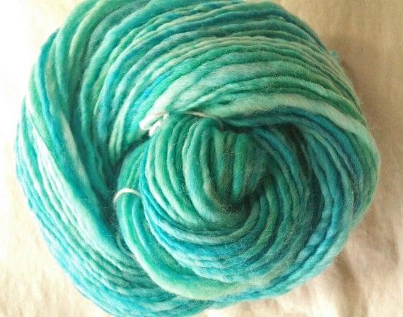Surf and Seafoam. Hand spun, hand painted , Art yarn. Pure merino wool.  Blues and greens..