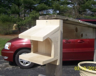 Bird house for doves,robins,cardanels curved sides