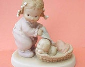 Adorable Baby with Puppy Porcelain Figurine by Lucie Attwell Ltd.