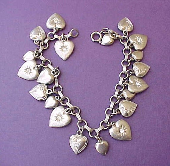 Lovely Vintage Charm Bracelet with 20 Little Heart Charms