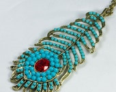 vintage style beautiful peacock feathers necklace, made with blue beads and red crystal