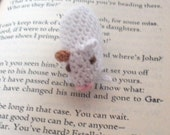 White Amigurumi Hamster with a Brown Ear and Paw