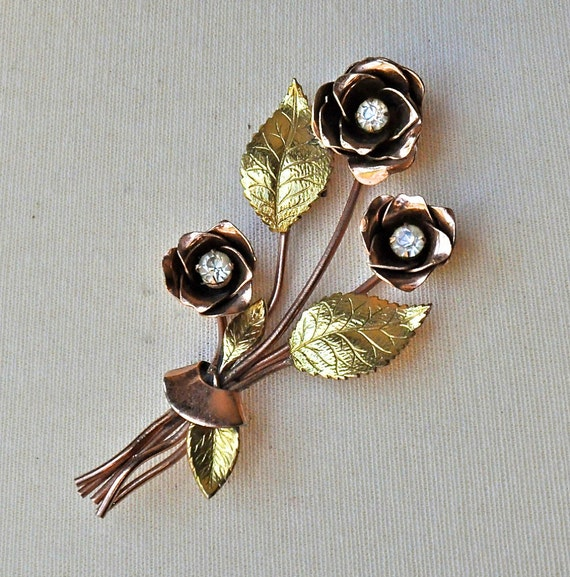 Stunning vintage 1945 Coro Copper and Gold Floral Brooch
