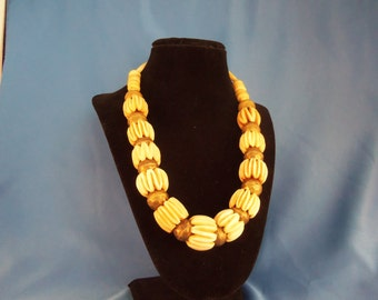 Large bone color textured beads with brass beads and great clasp (N39)