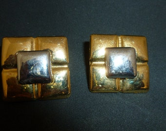 Gold and silver square clip earrings. (C55)