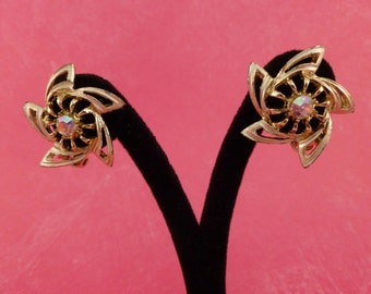 Gold swirl flower with colorful rhinestone center clip earrings(C56)