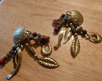 Southwestern beaded and leaves clip and pierced earrings. (106)