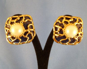 Navy clip Earrings with Pearl center and gold swirls