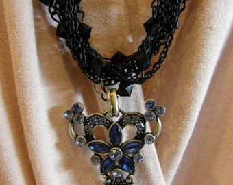 Stunning Black Stranded Necklace with Blue Rhinestone Pendant