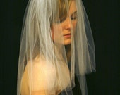 two tiered white elbow length veil