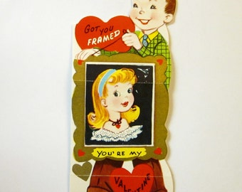 UNUSED Vintage Valentine Card of a Boy holding up a Picture of a Girl from the 1950's in MINT condition