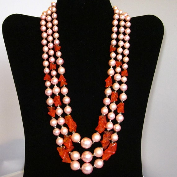 Vintage 3 Strand Beaded Pearl and Chevon Necklace in Peachy Pink Orange from the 1950's