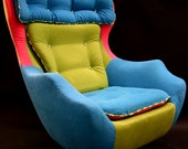 Fred, A reupholstered 1960's swivel egg chair.
