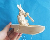 "Hand Carved Moving Wooden Toy ""Rabbit in the boat"""