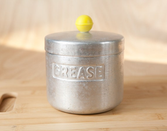 Aluminum Grease Canister, Can w/ yellow plastic knob by Turner Specialty, Houston Texas