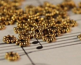 100 pcs Antique Gold Daisy Spacer Beads 5mm (GMB182)