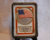 Vintage framed patriotic advertising piece with flag and motto