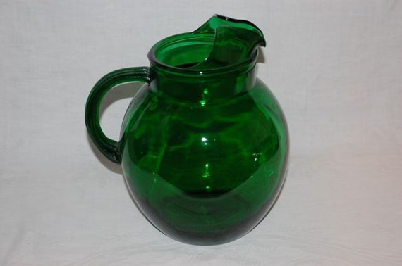 Vintage Anchor Hocking forest green ball pitcher with ice lip and reeded handle 1950's