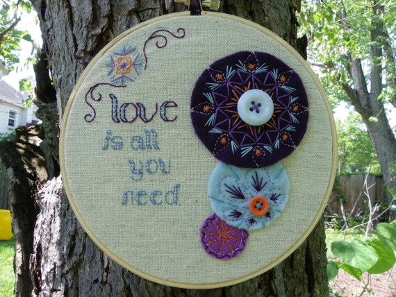 """Purple """"Love is all you need"""" Hand Embroidered Hoop Art"""