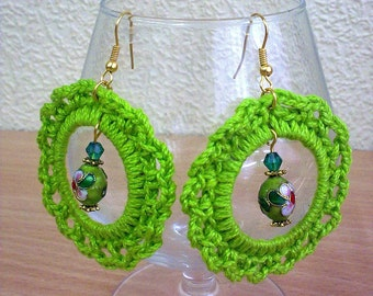 Bright green crochet earrings.