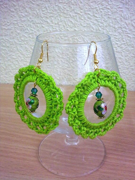 Bright green crochet earrings.