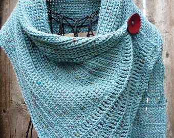 Turquoise buttoned wrap with a big red button. Very soft and