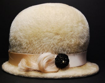 1960s Cream Brushed Fur Felt Hat with Black Flower with Faux Pearl, Matching Tassel and Ribbon, Body Made by Martelle in West Germany