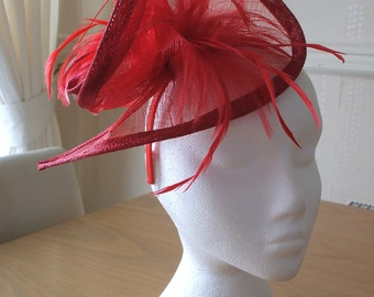Red Sinamay and Feather Fascinator Formal Hat, on a hairband. Ideal for a wedding, the races, Melbourne Cup