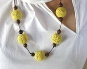Crocheted yellow cotton and wood necklace