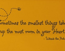 """WINNIE the POOH Quote """"Sometimes the smallest things take up the most room in your heart."""" wall vinyl decal"""