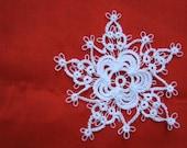 Tatted rose snowflake.