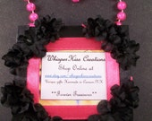 Picture frame with black silk flowers and hot pink beads