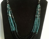 Long Aqua, black and clear seed bead multi strand necklace