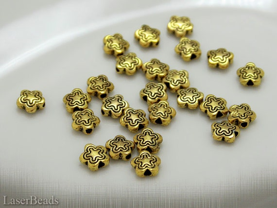 Metal Flower Beads 7mm (25) Antiqued Gold colour