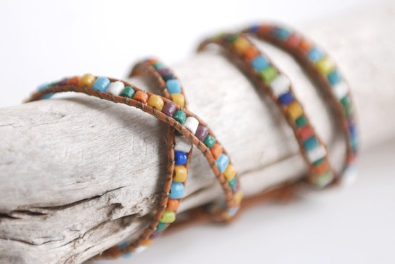 Double wrap leather bracelet with recycled glass african beads and big african sand cast button. Tribal look. WGA2v002