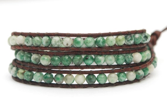 Beaded leather wrap bracelet. Green and white jade triple wrap leather bracelet with solid silver plated button. WSR3v012